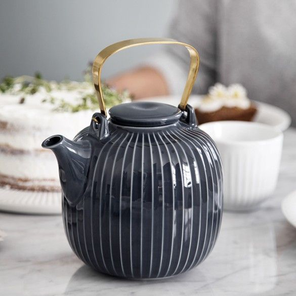 The teapot has an elegant, modern idiom with a decorative, brass-coated handle and a practical built-in strainer, which easily separates the tea leaves from the tea, if you brew your tea in the traditional way.