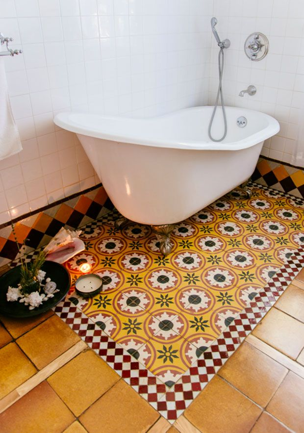 what one could do with this idea, is have just the edge of the bath (ordinary type/boxed in) done with tiles and the rest flooring of some sort- would that work?