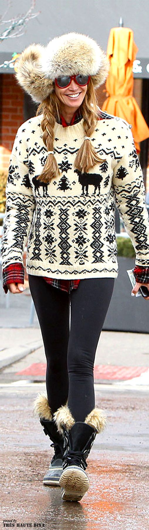Elle Macpherson in fur trapper hat and Nordic sweater | The House of Beccaria Plaid shirt