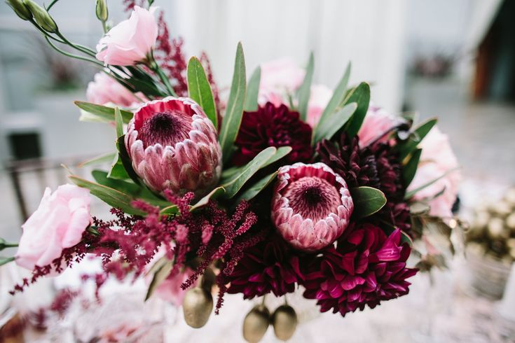 Burgundy bouquet with protea and astilbe