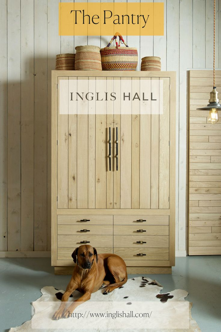 The freestanding pantry or larder in our kitchen showroom made of sawn oak and handles by Ged Kennett. Ridgeback dog not included! See more from Inglis Hall at http://www.inglishall.com/