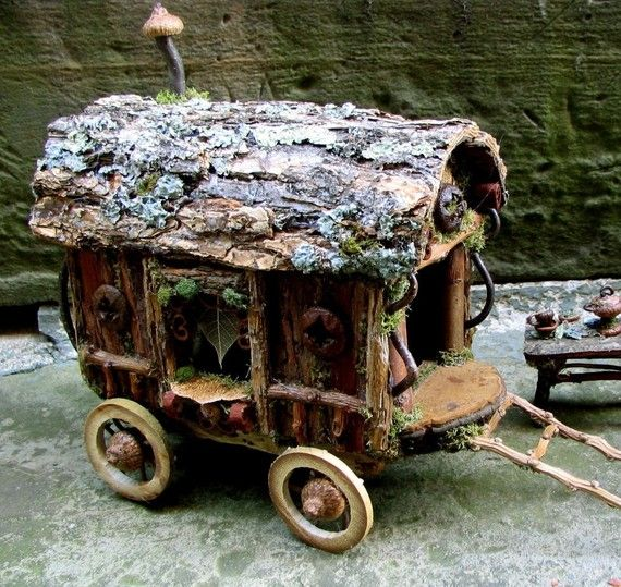 A traditional caravan for traveling wee folk composed of all natural materials such as birch and sycamore bark siding, shelf fungus drivers seat, and