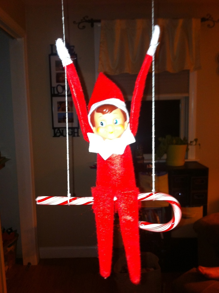 Oh, he floats through the air  With the greatest of ease,  This daring young Elf  On the flying trapeze!: Shelf Idea, Christmas Elf, Shelf Candy, Shelves, Candy Cans, Canes Swings, Candy Canes, Christmas Trees, Elf On The Shelf