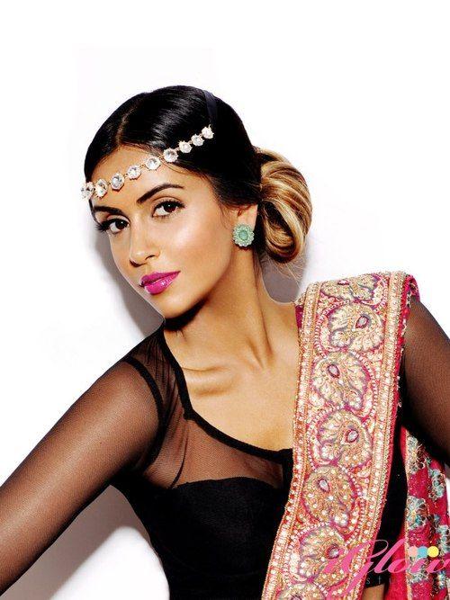Black mesh blouse and fancy sari.
