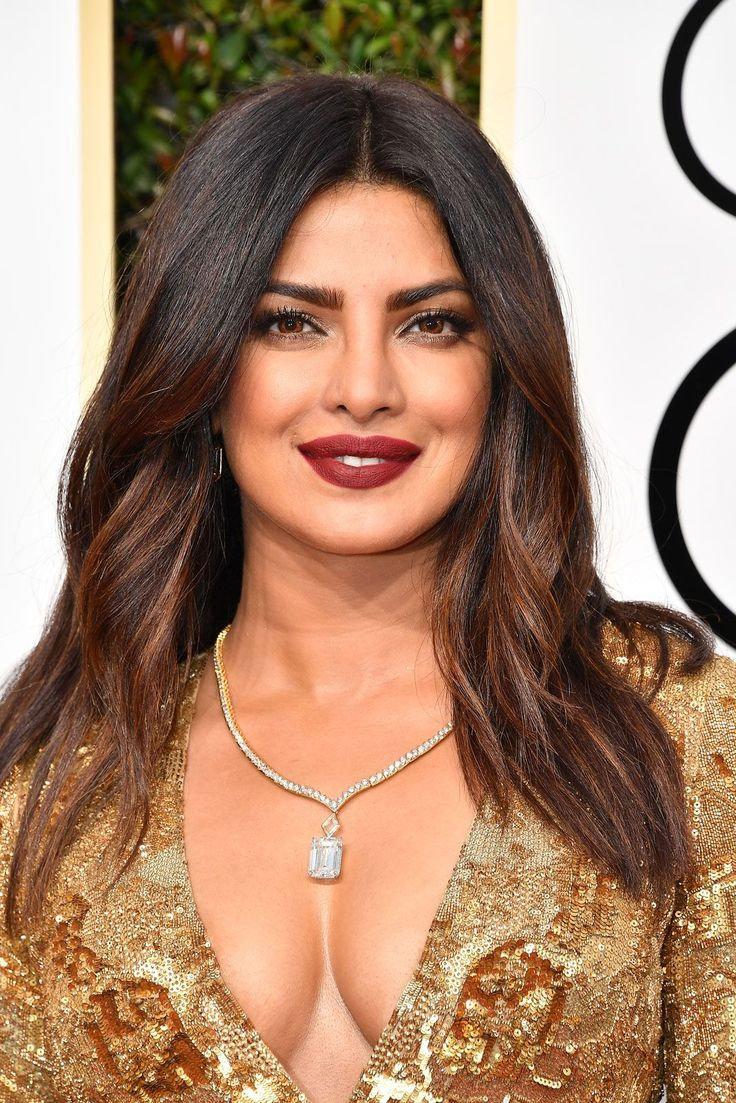 The Best Beauty Looks From The Golden Globes  #refinery29  http://www.refinery29.com/2017/01/135131/golden-globes-2017-best-hair-makeup-photos#slide-9  Priyanka ChopraThe Quantico star stunned in a classic combo — gold and red — made moodier with the darker, matter lip shade courtesy of Laura Mercier's Velour Lovers Lip Colour in An Affair and Seduction. ...