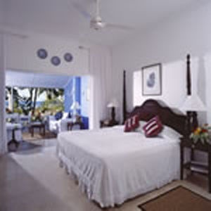 Jamaica Inns accommodations are spacious, impeccable and very tasteful. Beds are always freshly made, even after an afternoon nap. There are no TVs, radios or clocks to intrude between guest and rest.Each suite has a private balustrade balcony or large verandah overlooking the water. Balconies and verandahs come complete with a full sized sofa, wing chair, breakfast table, writing desk & coffee table. The propertys suites are equipped with air-conditioning, ceiling fans and your choice of…
