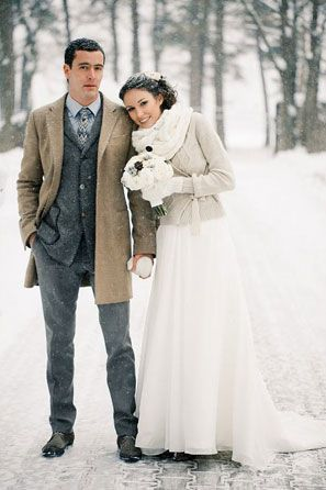 Shawl sweaters are also really distinguished options for winter or lodge events. This groom's heavy button-up sweater and camel overcoat is just plain practical for the snowstorm churning around them.