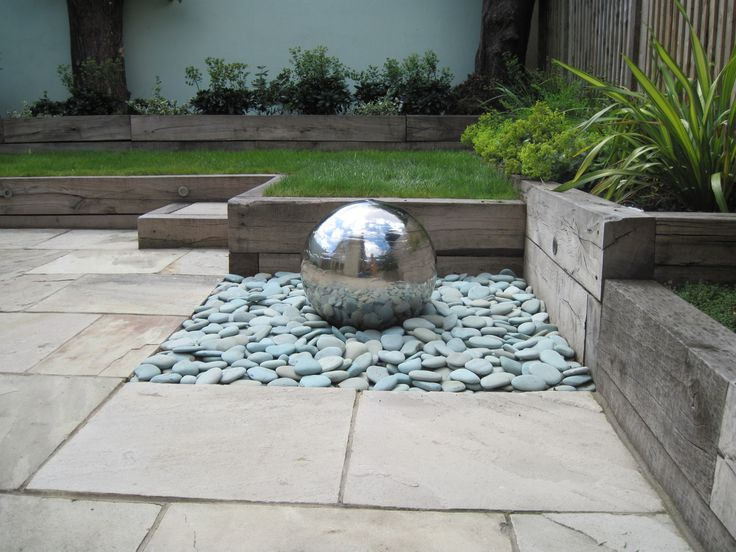 Just love these Stainless steel water features ...something similar but on a bed of white cobblestones