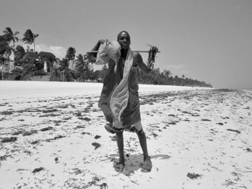 A Maasai tribesman offers trinkets for sale, Diani Beach