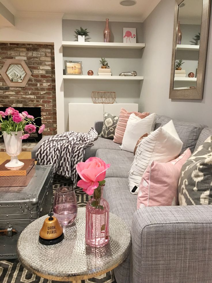 Pinks And Grays Patterns All Pair Well Together To Create A Cozy Entertainment Space Gray Couch Living RoomBrick