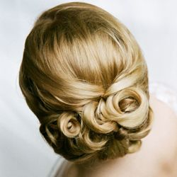 Super Pretty!!  This bride's hair is softly curled and set low to fit perfectly with her mantilla veil.