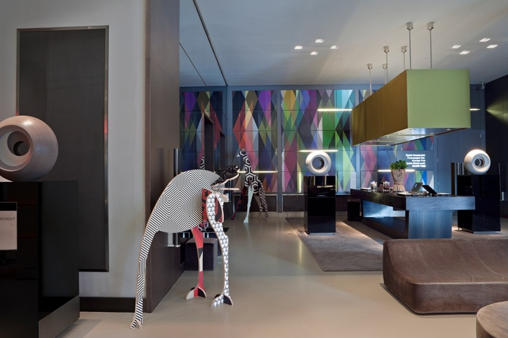 Cole & Son wallpapers and cool dinos. Andaz hotel lobby, London. Circus multicoloured wallpaper.