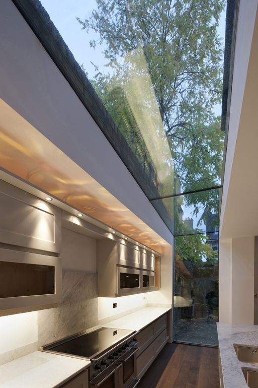 A great example of the glass slot approach. Framing the garden, sky views and an all round great architectural feature