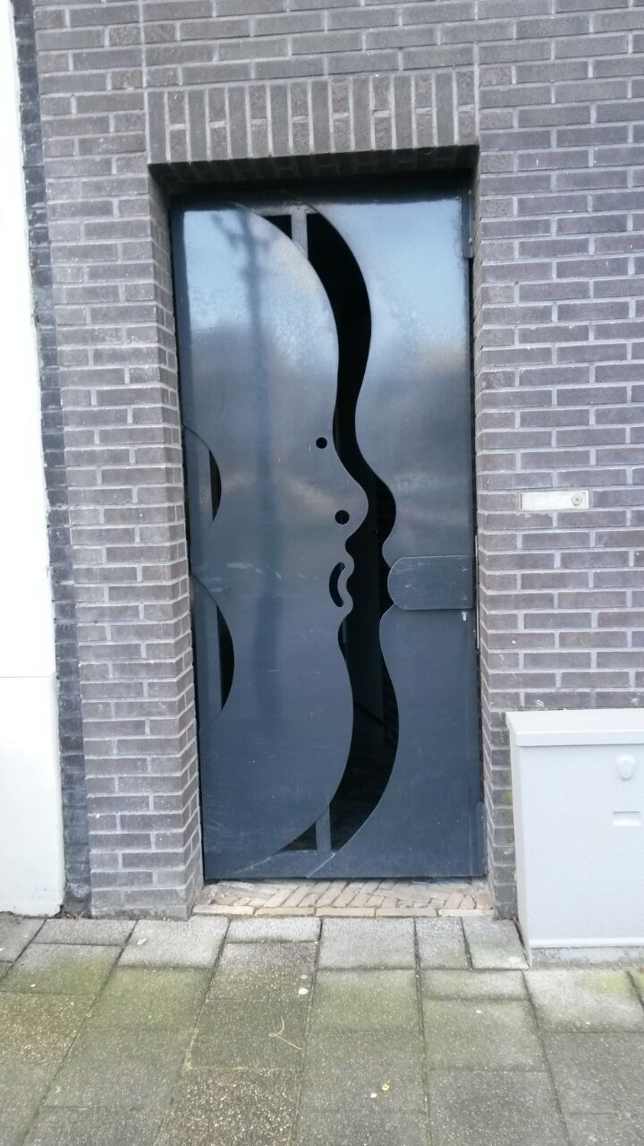 "Rein Dool. Door at ""Strateman complex"" Kuipershaven, Dordrecht. The Netherlands"