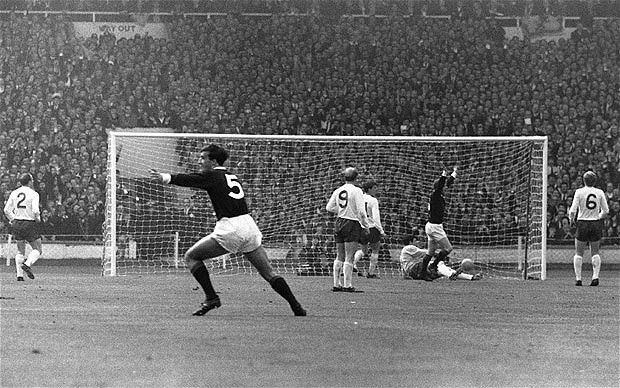The Law man puts Scotland on the way to beating the World Champions much to the delight of Ronnie McKinnon (No.5)