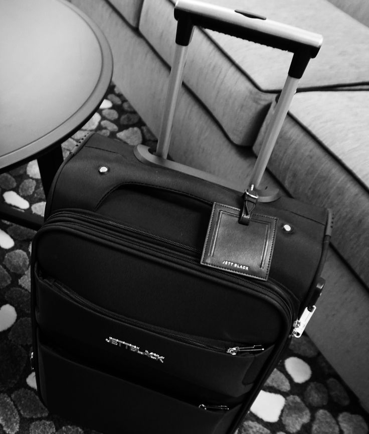 Raven Black Carry On & Jett Leather Luggage Tag by Jett Black