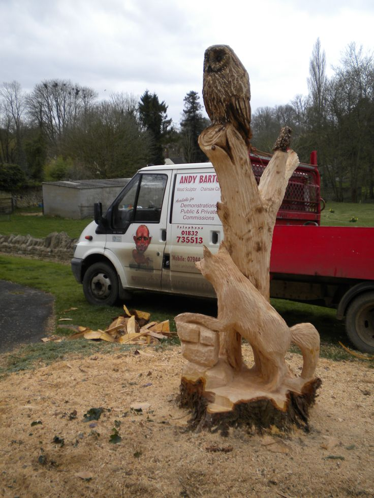 Garden tree stump chainsaw carved into owl and fox