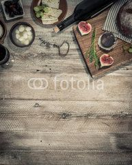 cheeses and brown bread on wooden table