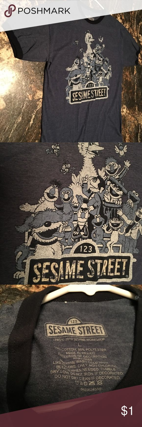 Sesame Street T-shirt Size L Soft Tee Big Bird Sesame Street T-shirt Size L Soft Tee Big Bird Oscar the Grouch Elmo Bert Ernie with no rips or tears. Please see pictures as they are part of the description. Sesame Street Shirts Tees - Short Sleeve