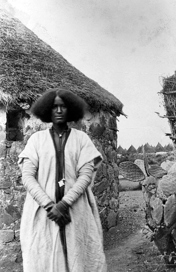 Africa   A Gala woman stands stoic and poised for an informal portrait.  Somalia.  1909   ©Gentilucci Italo
