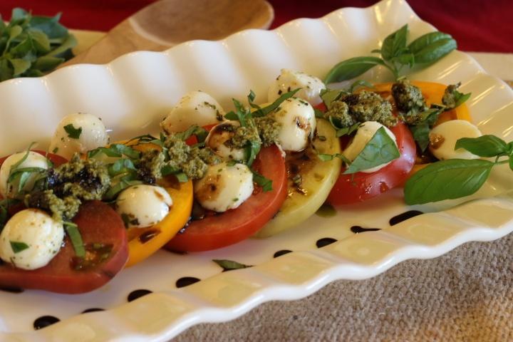 Healthy and delicious heirloom tomato and mozzarella caprese