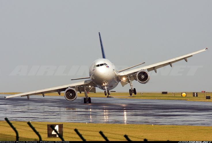 SATA International A310-325  Landing in heavy crosswinds at Lajes in the Azores, look at right main  gear! Pilots pulled it out and landed safely. Photographer Paulo Santos-Aerospray