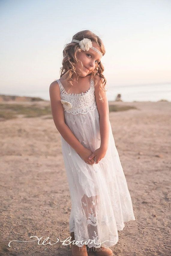 With a beautiful vintage inspired look, this dress is perfect for any little girl and occasion! You will fall in love with this super chic feminine boho inspired dress featuring gorgeous light ivory crochet top, delicate lace embellishment throughout, and adorned with a beautiful vintage inspired embellished light ivory flower. The dress is fully lined and features a crochet tie closure. So sweet, pretty, and perfect.  {Perfect For} Country weddings Beach weddings Flower girls Sunday dress…
