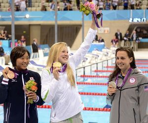 Jul 30, 2012; London, United Kingdom; Satomi Suzuki (JPN), left, and Ruta Meilutyte (USA), middle, and Rebecca Soni (USA), right, pose with their medals after the women's 100m breaststroke finals during the London 2012 Olympic Games at Aquatics Centre. Mandatory Credit: Richard Mackson-USA TODAY Sports