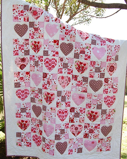 Pink nine-patches alternated with appliqued hearts... What if only half the hearts were there?