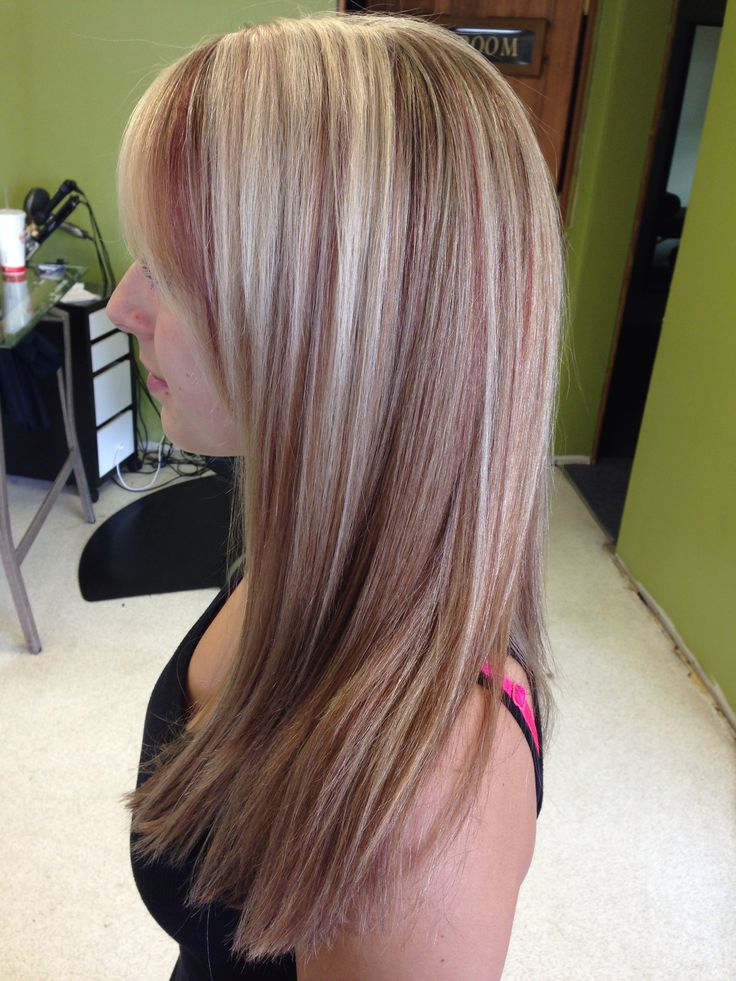 Blonde with subtle red lowlights. Hair by Trisha hackney