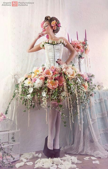 """I am not sure who the artist is on this dress, but YES I love the flowers! The draping feeling of the longer stemmed flowers and the puffy """"material"""" towards the top caused by the amount of flowers is so amazing. I love this piece...and if I were more outgoing and comfortable in my own skin...I would even wear this myself."""