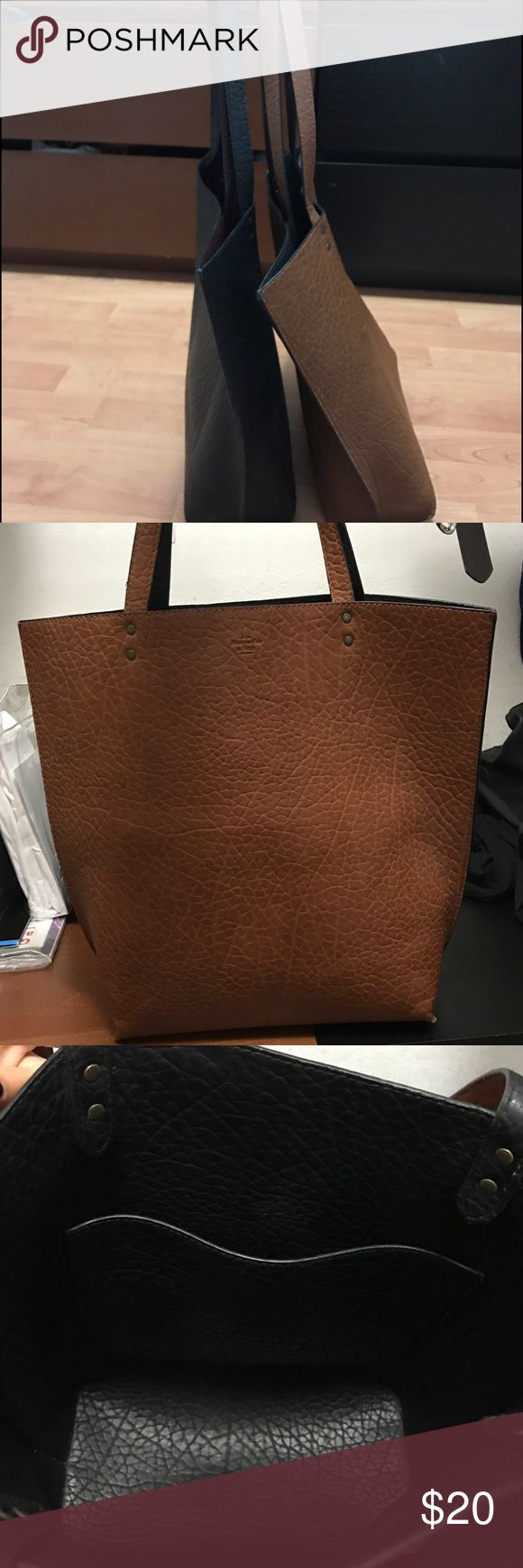 Abercrombie & Fitch handbag. Abercrombie & Fitch handbag. Reversible. Brown and Black. Shoulder handbag. Very spacious. Comfortable and calls a lot of attention. Perfect for any occasion. Work, beach, daily handbag. Abercrombie & Fitch Bags Shoulder Bags