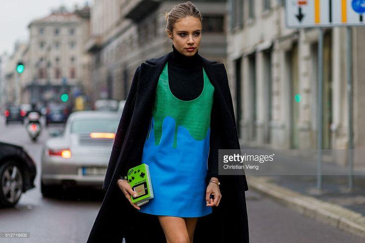 Xenia Tchoumitcheva wearing a Pinko coat, Au Jour Le Jour dress seen outside Blumarine during Milan Fashion Week Fall/Winter 2016/17 on February 27, 2016 in Milan, Italy. Urania Gazelli Game Over clutch bag plexiglass