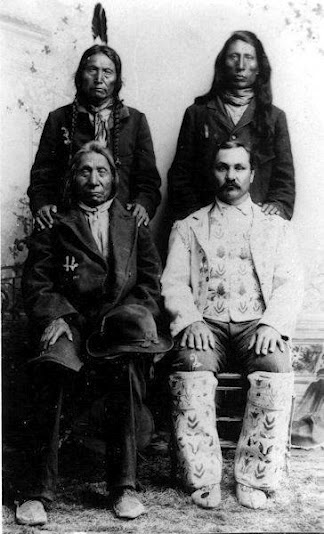 """Standing L-R: Knife (Oglala), Jack Red Cloud (Oglala) the son of Red Cloud Sitting L-R: Red Cloud (Oglala), Baptiste """"Little Bat"""" Garnier (Oglala/French Canadian) - 1897 {Note: Baptiste Garnier was called """"Little Bat"""" to distiguish him from the French Canadian Scout and Interpreter named Baptiste Pourier who was called """"Big Bat"""". The term """"Bat"""" was a shortened version of Baptiste. Both men married Oglala women and lived on Pine Ridge.}"""