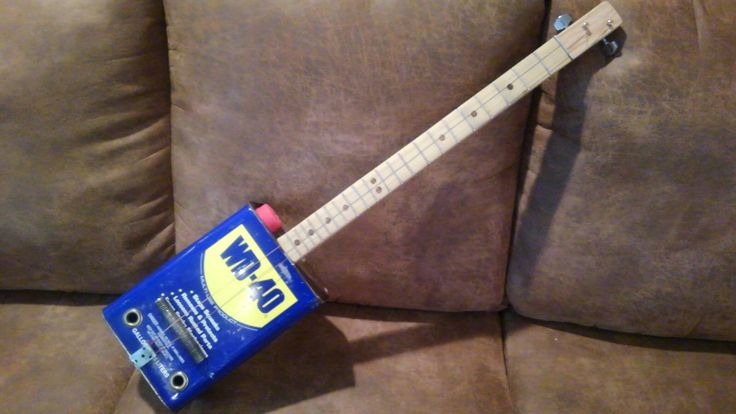 2 stringer WD-40 can guitar.    Red oak neck, poplar fingerboard, welding wire frets, and custom WD-40 finish on the wood.
