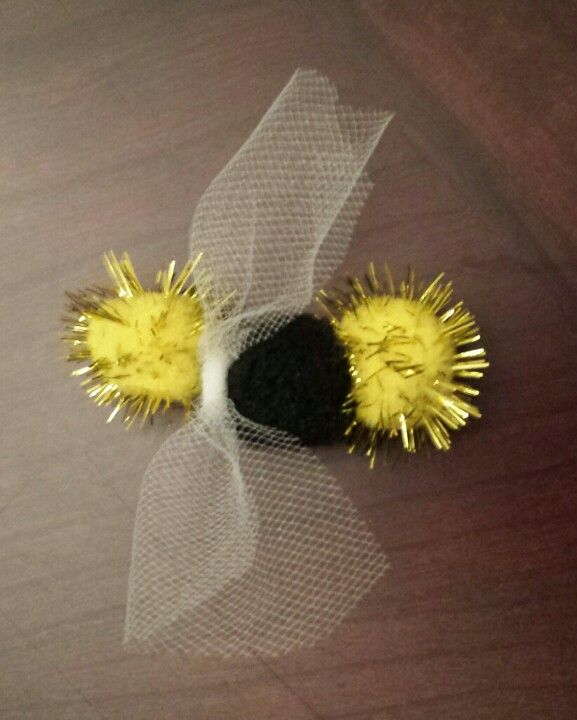 My troop ' s little bee craft to go with Chapter 2 of daisy flower garden journey. Used a large safety pin and pierced the 3 pompoms, tied on a strip of tulle for wings, and later we added googly eyes. Would also be a great swap.