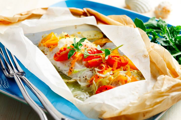This recipe will help you avoid overcooking white fish. By using parchment paper and creating little pockets of moisture, your potatoes and vegetables cook all in one package and your fish will always be moist and flavourful. You can use any firm white fish.