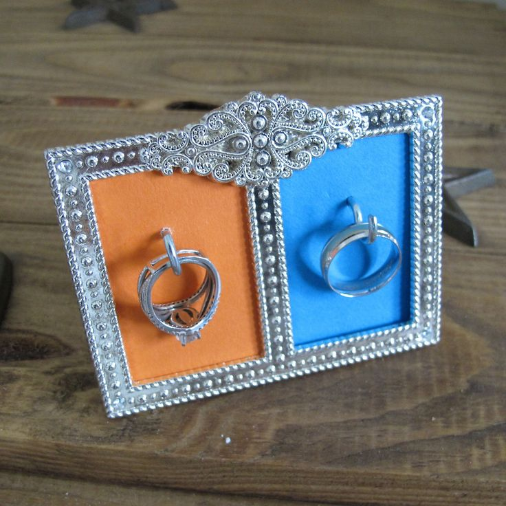 DIY Wedding Ring Holder - Use a small frame and some hooks to create your own ring holder! Could work great in the kitchen!