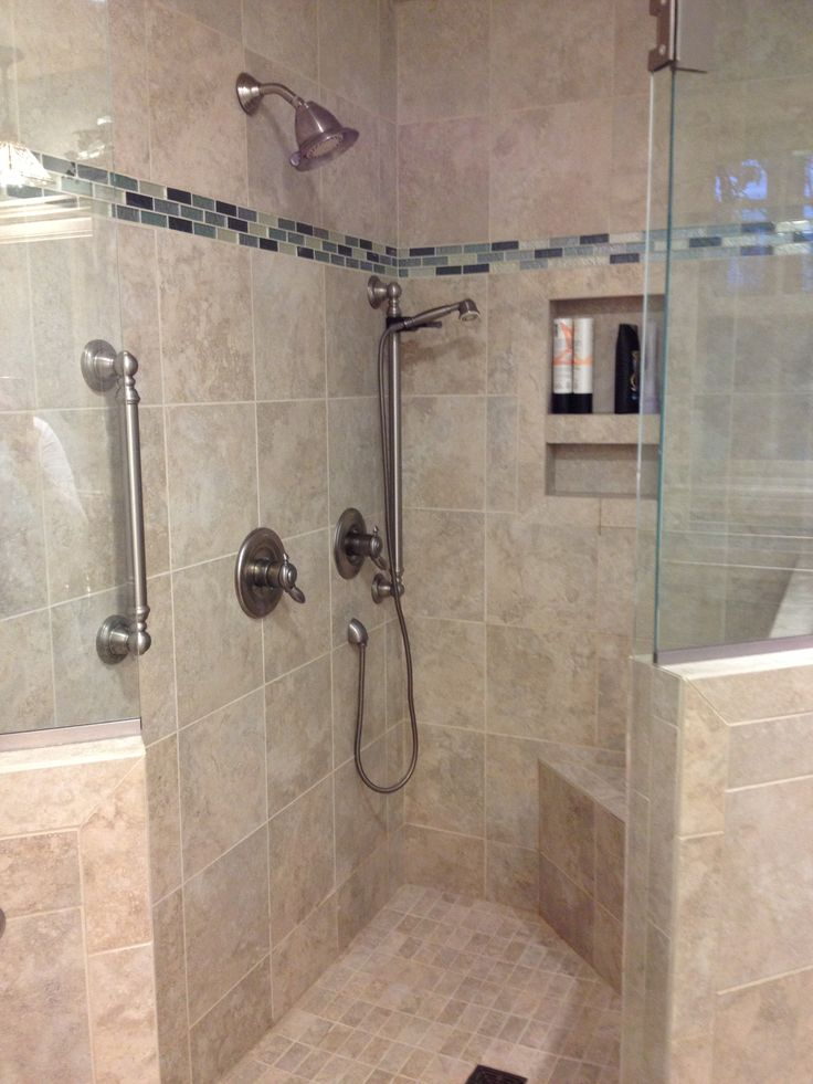 this custom tile shower has a built in shower caddie 11598