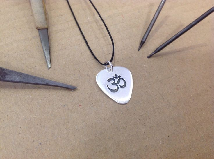A personal favourite from my Etsy shop https://www.etsy.com/listing/211221520/mini-silver-handmade-unique-guitar-pick