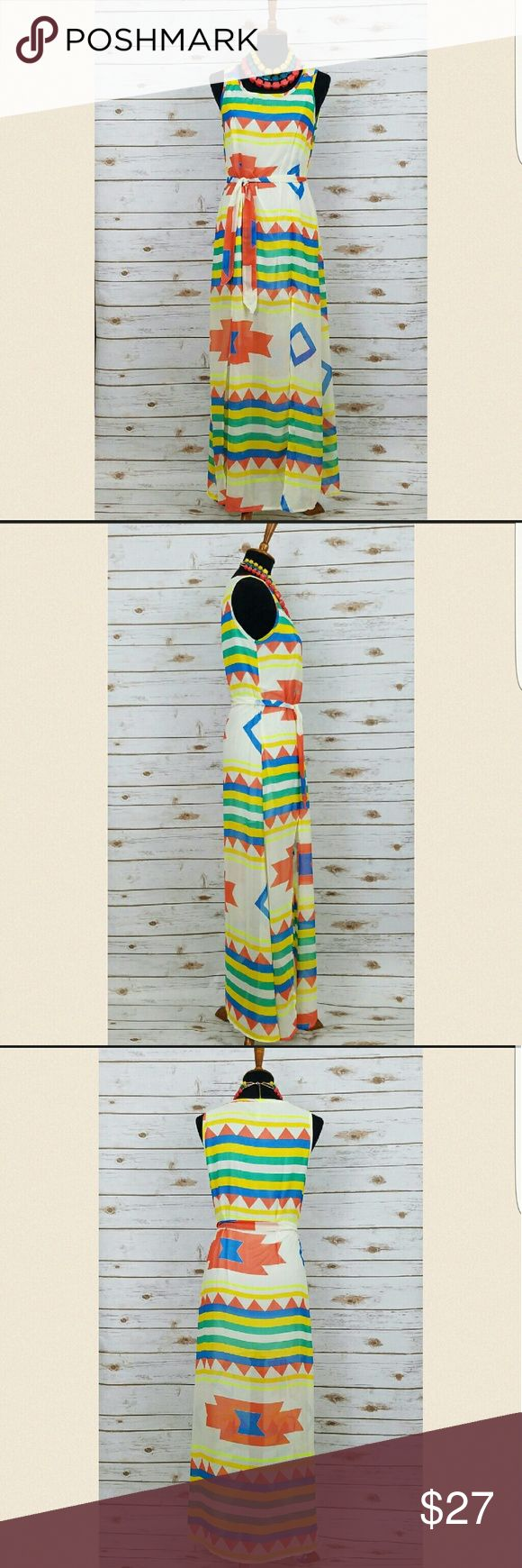 """🎀NEW ARRIVAL MULTI-AZTEC DOUBLE FRONT SLIT DRESS Stay cool this Spring and Summer with this MULTI COLORED AZTEC PRINT DOUBLE FRONT SLIT DRESS!  This dress is made of a semi-sheer Silk material and it has a partial lining for modesty with a belt that is included .   The front slits and the lightweight material gives it a great """"flowing"""" effect when you walk.  Super CUTE!  😍  53"""" Long (measured from back)  Bust (Armpit to Armpit) (S) 19.5"""", (M) 20.5"""",  (L) 21.5"""" Dresses Maxi"""