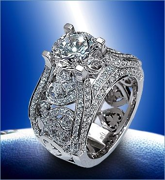 """2.5ct Round Brilliant diamond center stone surrounded by everything gorgeous. """"LIKE"""" us on FB https://www.facebook.com/MSImagines?v=wall"""