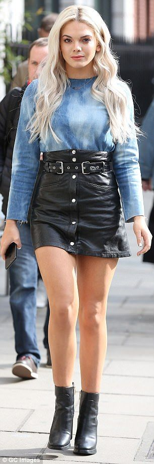 Pin-credible: The 19-year-old X Factor winner flaunted her toned pins in her thigh-skimming leather mini skirt