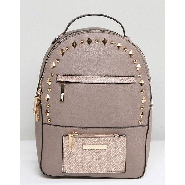 Dune Studded Backpack ($65) ❤ liked on Polyvore featuring bags, backpacks, beige, day pack backpack, studded bag, fake leather backpack, vegan leather bags and vegan backpack