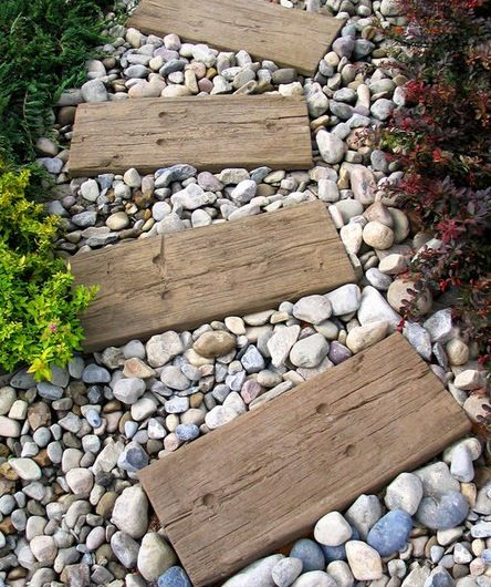 reclaimed wood planks on gravel for a garden path... pretty!
