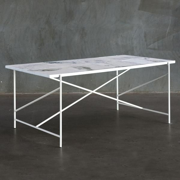 HANDVÄRK's all-white marble dining table is a statement piece that exudes luxury Nordic appeal. Made by hand in Denmark, this chic edition of the HANDVÄRK dining table is an ultra-modern take on a tile top table, with large-format pieces of white marble mounted in a slender white frame.