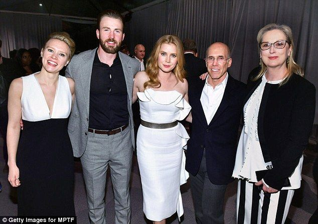 Lovely as always: Meryl Streep posed with (L-R)  Kate McKinnon, Chris Evans, Amy Adams, and CEO of DreamWorks Animation Jeffrey Katzenberg and actor Meryl Streep attend MPTF's The Night Before at Fox Studios in LA on Saturday