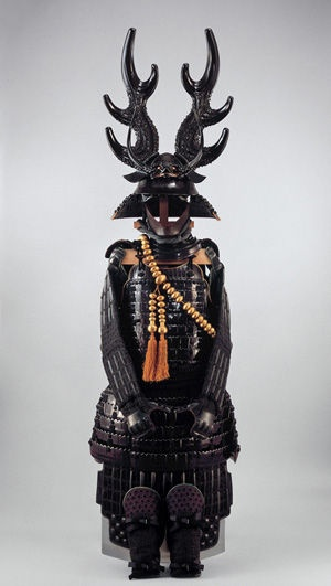 Dō-Maru Gusoku Armor with Black Lacing and Three-Branched Deerhorn Helmet, Momoyama period, late 16th century. Iron, lacquer, leather, wood, papier-mâché, and silk; H. of helmet bowl: 7 in. (17.8 cm); H. of cuirass: 15 3/8 in. (39 cm) Private collection