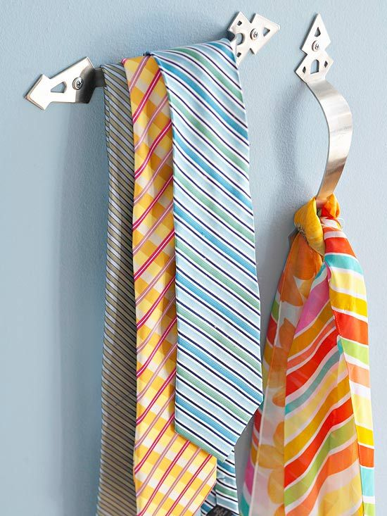 Small Closet Organization - use hardware to hang towels, ties, scarves, etc.