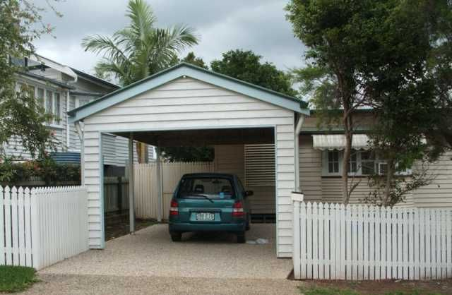 This carport is positioned in front of the house adding a for Carport fence ideas